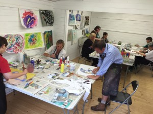 Workshop participants painting