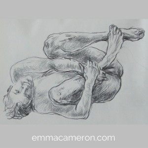 Life drawing of male model lying curled up