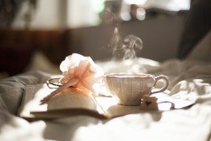 Teacup, book and pen. Photo by Carli Jean via Unsplash