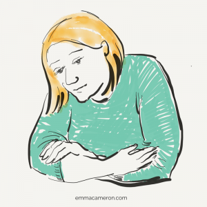 Woman with arms crossed, looking thoughtful, has feelings about infertility